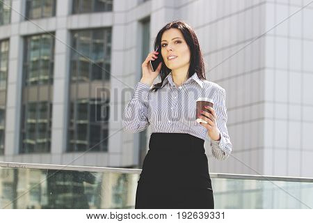 Successful Business Talk. Portrait Of Attractive Young Business Woman In Smart Casual Wear Talking O