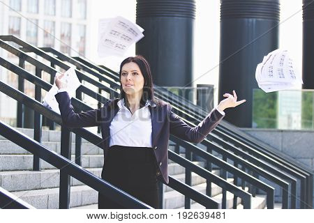 Hateful Work Done. Portrait Of Cheerful And Beautiful Business Woman In Smart Casual Wear Throwing P