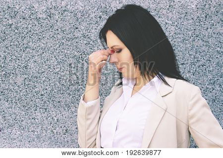 Feeling So Tired. Portrait Of Frustrated Business Woman In Smart Casual Wear Massaging Her Nose Whil