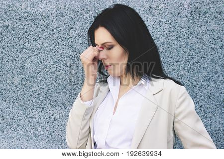 So Hard Day At Work. Portrait Of Tired Business Woman In Smart Casual Wear Massaging Her Nose While