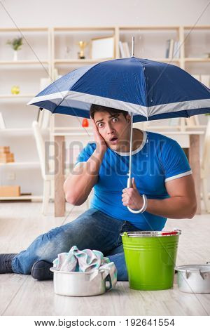 Man at home dealing with neighbor flood leak