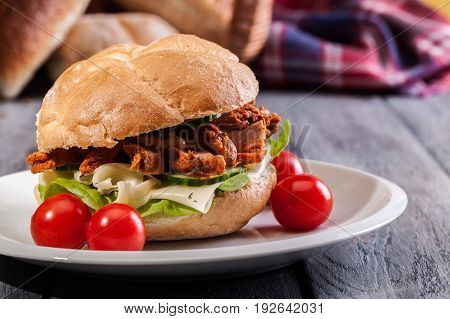 Fried Chicken Meat With Cheese And Vegetables In Bun