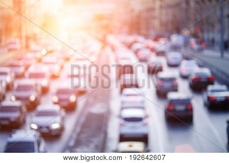 Blurred photo urban road with moving cars in morning