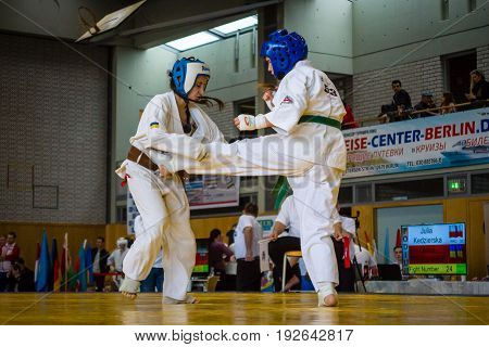 BERLIN - MARCH 18 2017:Girl-fighters on tatami. European championship Kyokushin World Union (KWU) for Children and Youth.