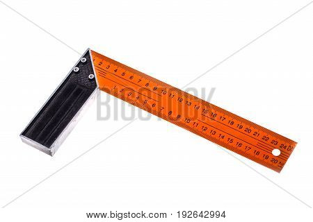 Photo of orange ruler close-up on white empty background