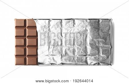 Chocolate bar in foil, isolated on white