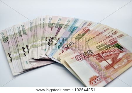 a lot of 5000 1000 1000 banknotes of Bank of Russia on white background Russian rubles spine 100 banknotes of five thousand rubles