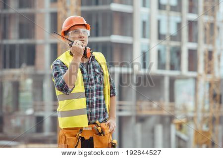 Male work building construction engineering occupation radio set
