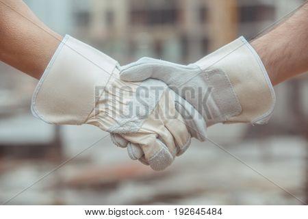 Male work building construction engineering occupation handshake