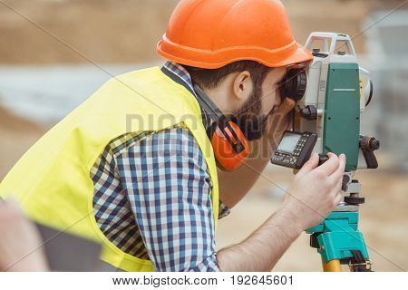 Male work building construction engineering occupation using theodolite