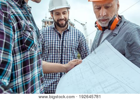 Male work building construction engineering occupation holding blueprint