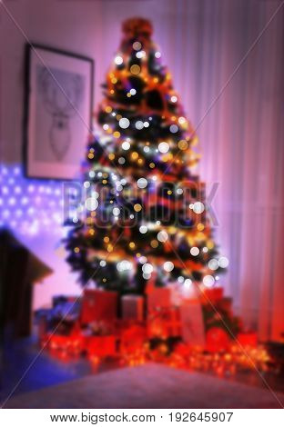 Blurred view of decorated Christmas tree with gifts at home. Happy New Year 2018