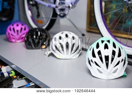 Shelf with bicycle helmets in shop