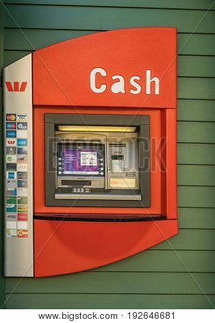 Arrowtown New Zealand - March 16 2017: Red public ATM machine cash dispenser in main street list images of all major credit and bank cards.