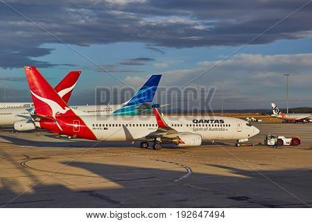 MELBOURNE - MARCH 15, 2016: Aircraft of the Qantas fleet taxiing to takeoff at Melbourne Airport. Qantas is Australia's largest airline.
