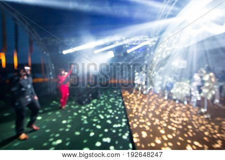 Blurred colorful lights inside music club - Abstract background with defocused bokeh of laser show in modern disco party nightlife - Party and entertainment concept