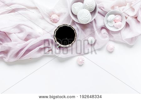 woman lunch with marsh-mallow, cup of coffee and fabric trendy design in soft light on white table background flat lay mock-up