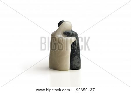 Hugging sculptures. Souvenir from the Philippines. Marble object. Art. Friendship. Love. Sympathy. White background.