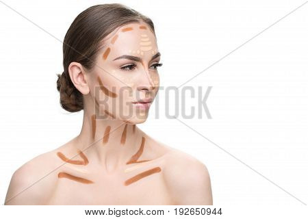 Thoughtful attractive lady is presenting way of usage various correctors on her face and looking aside with confidence in sight. Portrait. Isolated and copy space