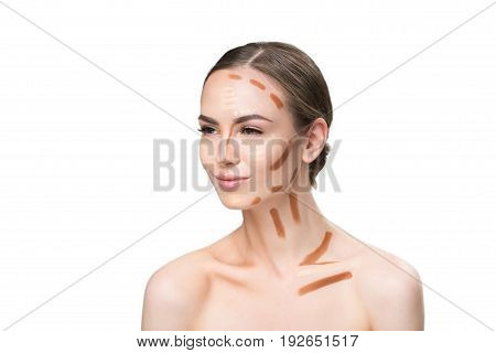 Confident attractive woman showing difference between half of face with shaded concealers and one which is not. She looking aside with assurance. Portrait. Isolated and copy space