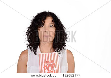 Portrait of beautiful woman eating popcorn and watching movies. Isolated white background.