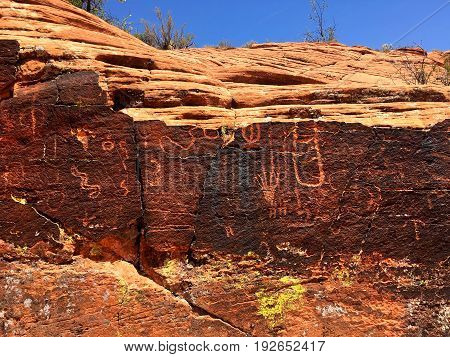 Ancient petroglyphs on the red rocks of Snow Canyon Utah