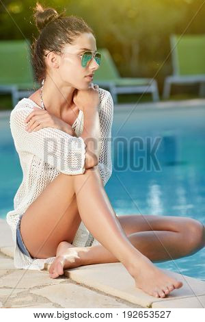 Vacation woman relaxing in pool  on summer holidays resort.