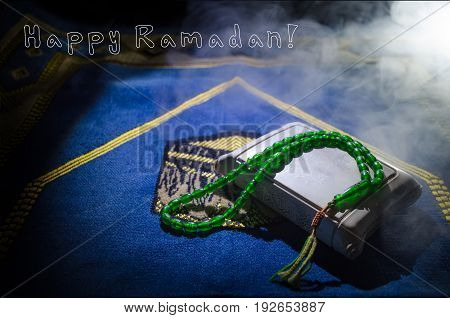 Holy Quran With Beads On A Prayer Mat, Muslim Tasbih Is A String Of Prayer Beads Which Is Traditiona