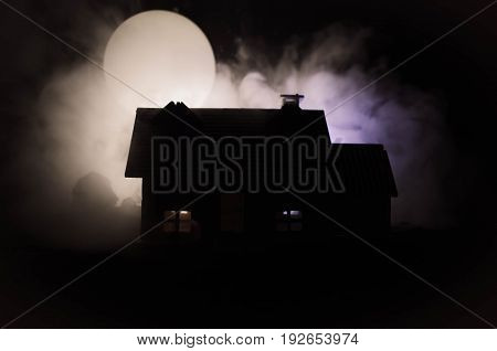 Old House With A Ghost In The Moonlit Night Or Abandoned Haunted Horror House In Fog, Old Mystic Vil