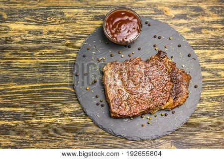 Grilled beef steak with sauce on the table