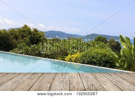 wooden floor with swimming pool overlooking view andaman sea mountains and blue sky backgroundsummer holiday background concept
