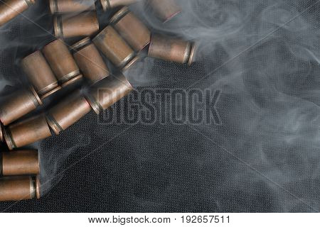 Empty Metallic Casings Under Small-caliber Pistols Which Lie In The Soft Haze