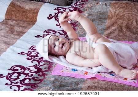 Little Girl Lies In A Towel After Washing
