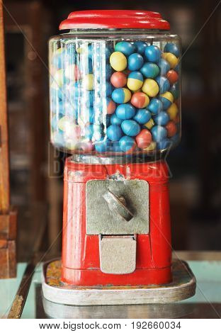gamble eggs in vintage gumball machine on glass counter at grocery store