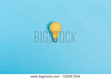 Colored light bulb on vivid colored background