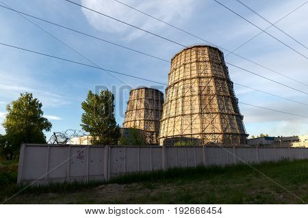 LIPETSK, RUSSIA - JUNE , 2017: NLMK Group. High cooling towers, cooling water in industrial production