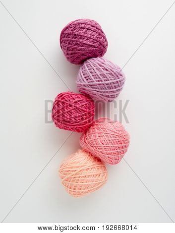 Knitting yarn balls in pink tone. Skeins of wool yarn for knitting.
