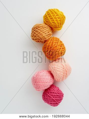 Knitting yarn balls in pink and yellow tone. Skeins of wool yarn for knitting.