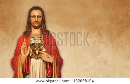 Sacred Heart Statue over grunge background with copy space