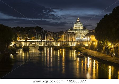 St. Peter's Basilica and Ponte Sant angelo at dusk in vatican city Rome Italy