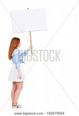 Back view  of woman showing a sign board. young redhead girl holds information plate. Rear view people collection. backside view of person.  Isolated over white background.