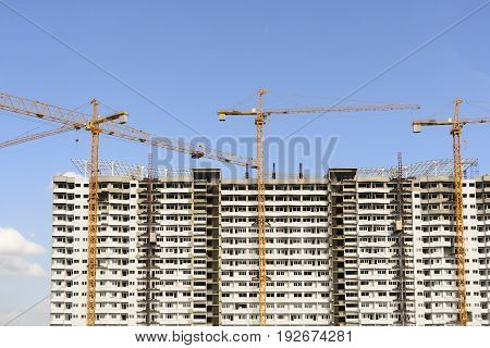 The construction site with the crane.Heavy construction industry.