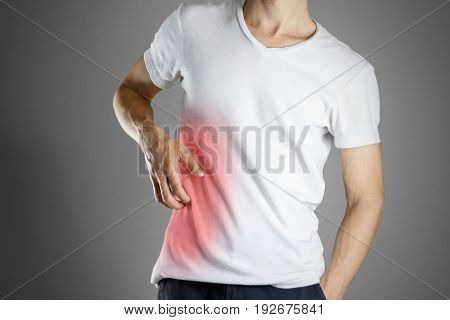Guy In White Shirt Scratching His Body. Scabies. Scratch The Body. Isolated