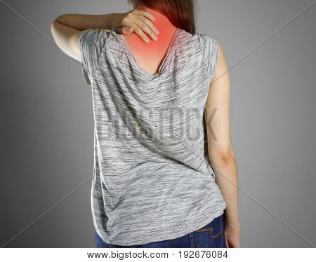 The Girl In Grey T-shirt Clings To The Back Of The Head. Pain In The Back Of His Neck. Isolated