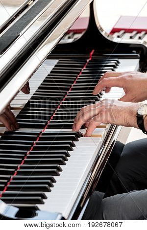 Musician Or Composer Playing Grand Piano And Touching Its Keys