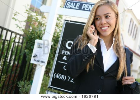 A beautiful young real estate agent woman on the phone poster