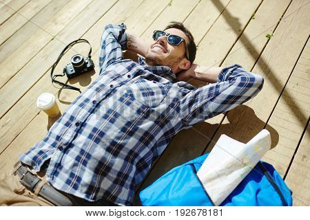 Young man relaxing on sunny day
