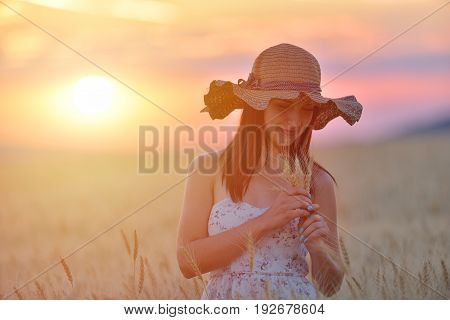 Closeup Portrait Of Smiling Young Caucasian Woman In Wheat Field. Cheerful Young Beautiful Woman Enj