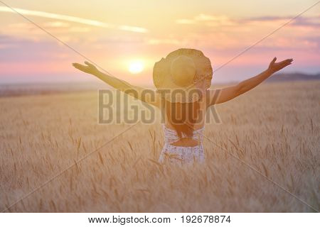 Woman feeling free happy and loved in a beautiful natural setting at sunet