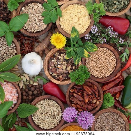 Dried herb and spice selection in wooden bowls and loose, high in antioxidants and vitamins.